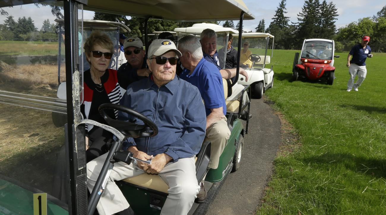 """Golfer Jack Nicklaus, front right, and his wife Barbara, left, pause while driving a golf cart, Tuesday, June 16, 2015, at the American Lake Veterans Golf Course in Tacoma, Wash. Nicklaus was inspecting the progress of the """"Nicklaus Nine,"""" nine new golf h"""