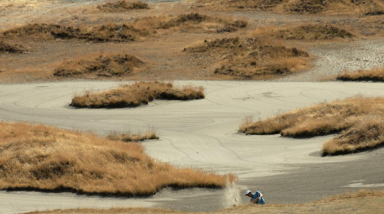 Martin Kaymer, of Germany, hits out of a bunker on the seventh hole during a practice round for the U.S. Open golf tournament at Chambers Bay on Tuesday, June 16, 2015 in University Place, Wash. (AP Photo/Charlie Riedel)