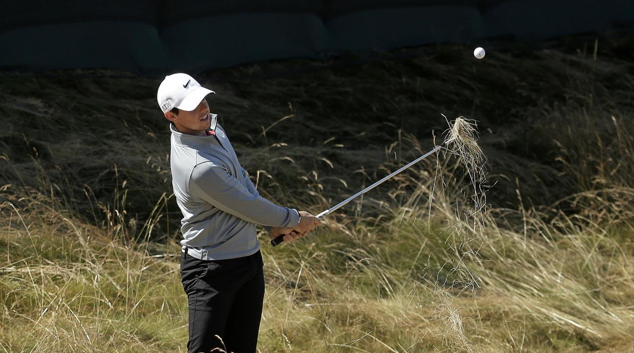 Rory McIlroy, of Northern Ireland, hits from rough on the 18th hole during a practice round for the U.S. Open golf tournament at Chambers Bay on Wednesday, June 17, 2015 in University Place, Wash. (AP Photo/Charlie Riedel)