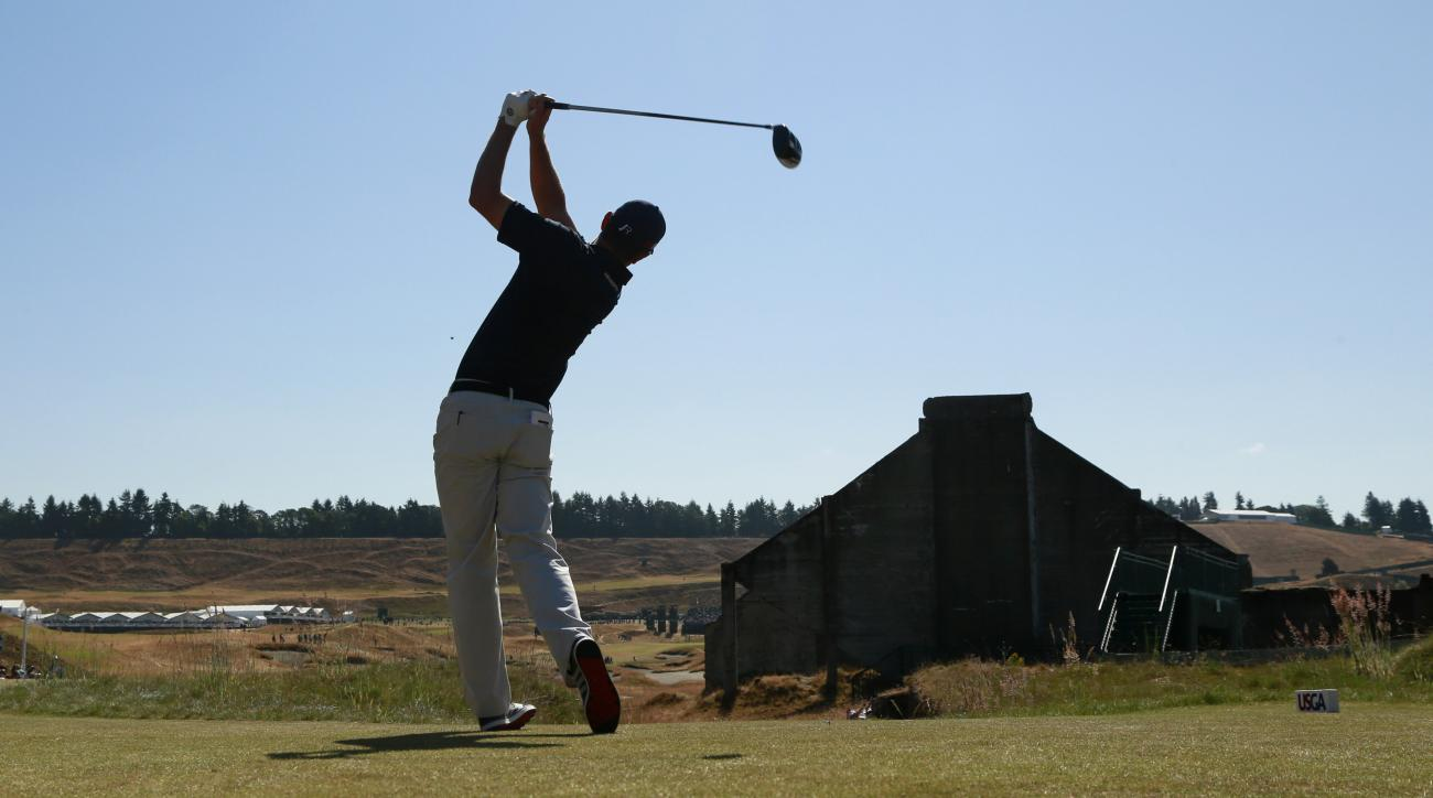 Justin Rose, of England, watches his tee shot on the 18th hole during a practice round for the U.S. Open golf tournament at Chambers Bay on Wednesday, June 17, 2015 in University Place, Wash. (AP Photo/Charlie Riedel)