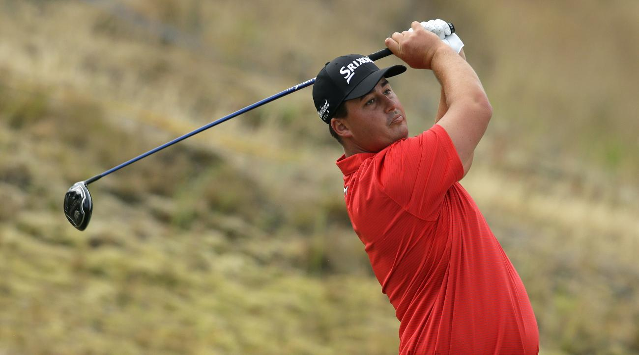 Michael Putnam watches his tee shot  on the fifth hole during the first round of the U.S. Open golf tournament at Chambers Bay on Thursday, June 18, 2015 in University Place, Wash. (AP Photo/Ted S. Warren)