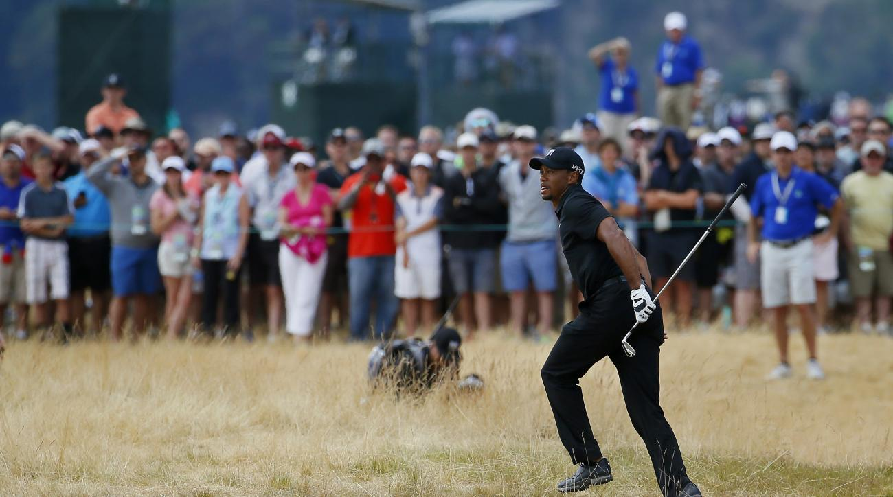 Tiger Woods watches his shot from the fairway on the sixth hole during the first round of the U.S. Open golf tournament at Chambers Bay on Thursday, June 18, 2015 in University Place, Wash. (AP Photo/Matt York)