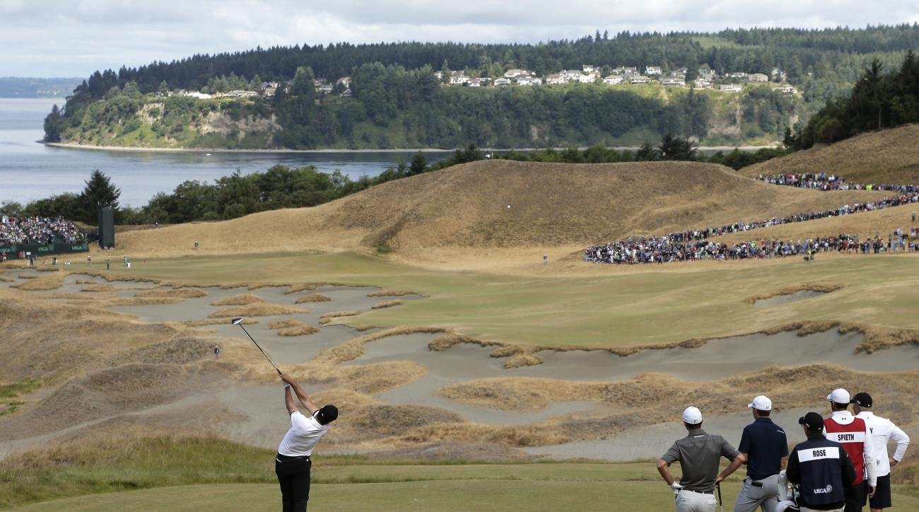 Jason Day, of Australia, watches his tee shot on the 14th hole during the second round of the U.S. Open golf tournament at Chambers Bay on Friday, June 19, 2015 in University Place, Wash. (AP Photo/Charlie Riedel)