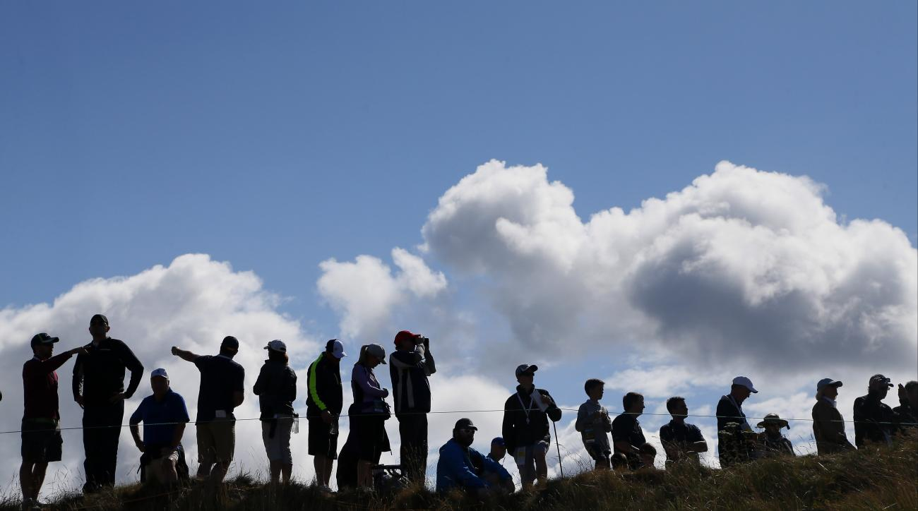 Fans watch along the fifth fairway during the second round of the U.S. Open golf tournament at Chambers Bay on Friday, June 19, 2015 in University Place, Wash. (AP Photo/Matt York)