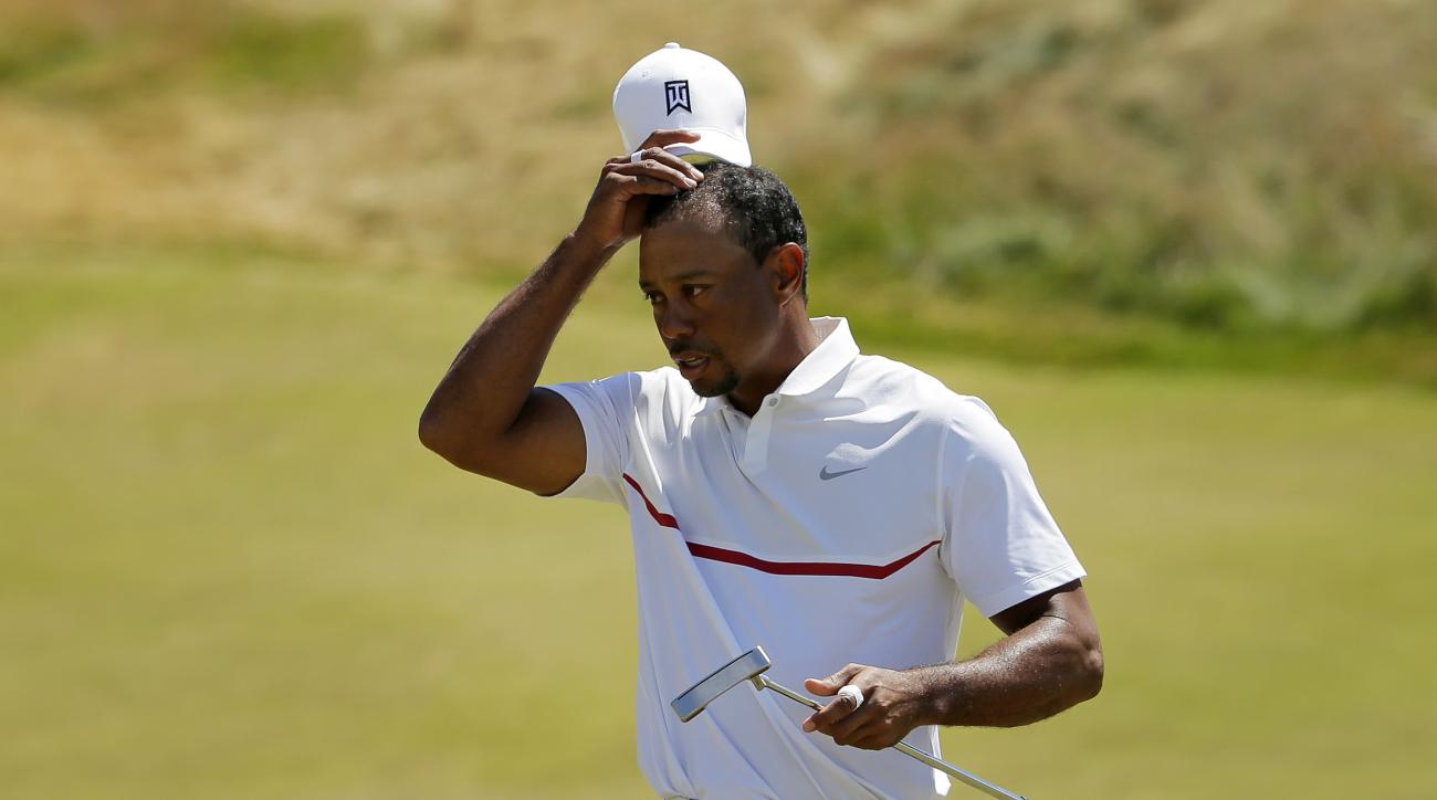 Tiger Woods removes his hat after his  second round in the U.S. Open golf tournament at Chambers Bay on Friday, June 19, 2015 in University Place, Wash. (AP Photo/Ted S. Warren)