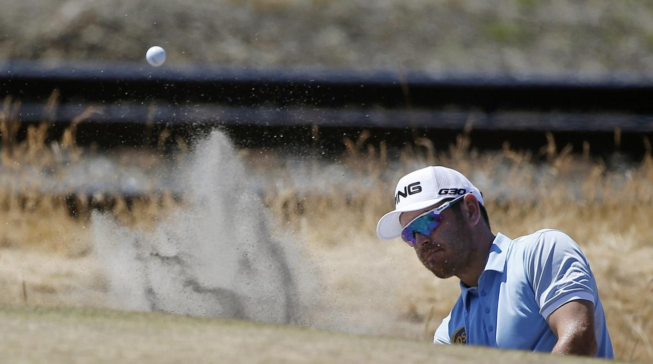 Louis Oosthuizen, of South Africa, hits out of the bunker on the 16th hole during the third round of the U.S. Open golf tournament at Chambers Bay on Saturday, June 20, 2015 in University Place, Wash. (AP Photo/Lenny Ignelzi)