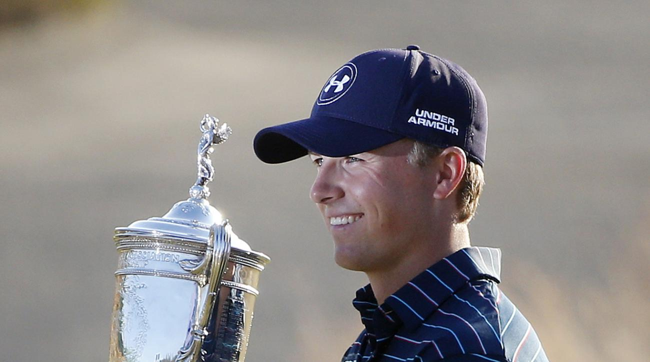Jordan Spieth holds up the trophy after winning the U.S. Open golf tournament at Chambers Bay on Sunday, June 21, 2015 in University Place, Wash. (AP Photo/Lenny Ignelzi)