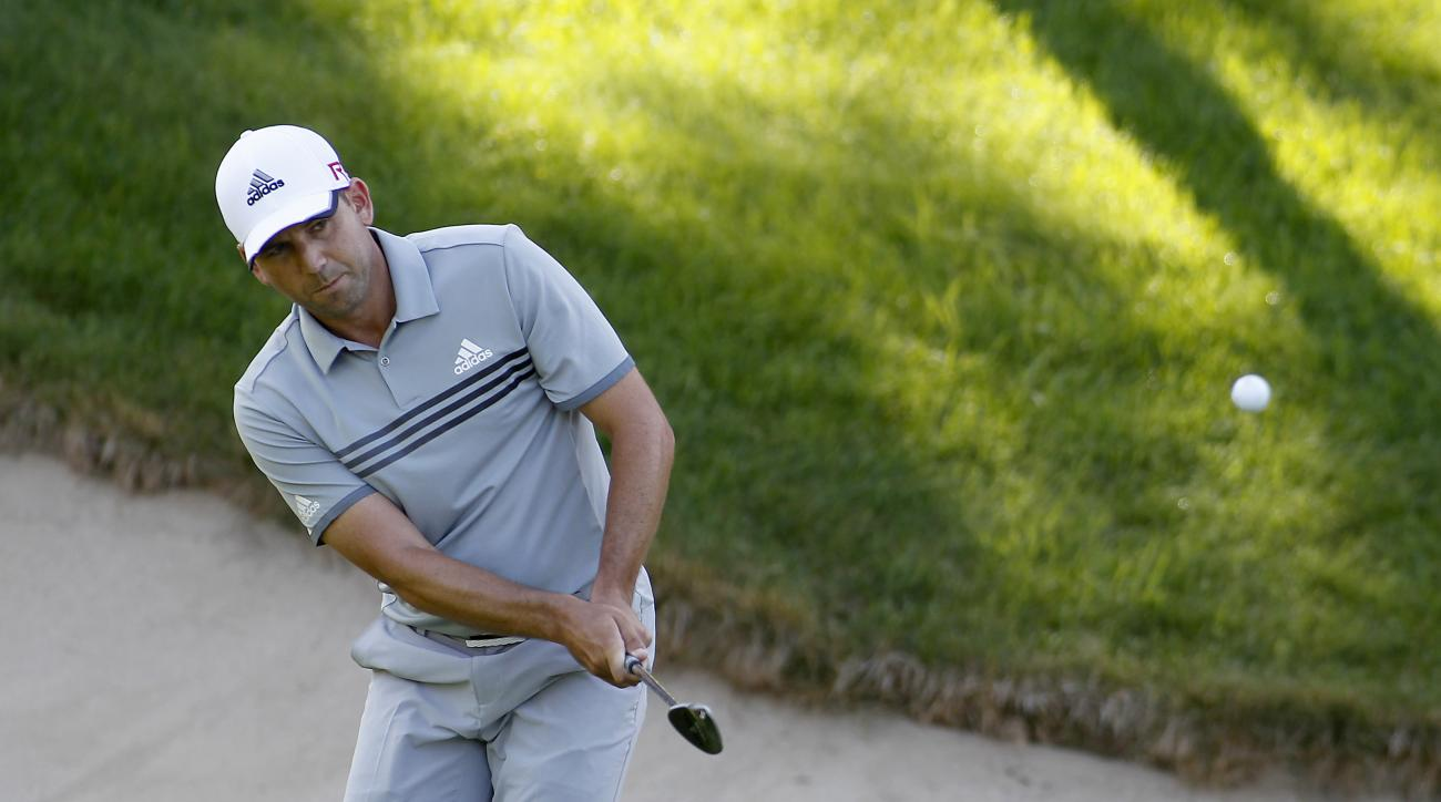 Sergio Garcia, from Spain, chips his second shot onto the 15th green during the first round of the Travelers Championship golf tournament in Cromwell, Conn., Thursday, June 25, 2015. (AP Photo/Stew Milne)