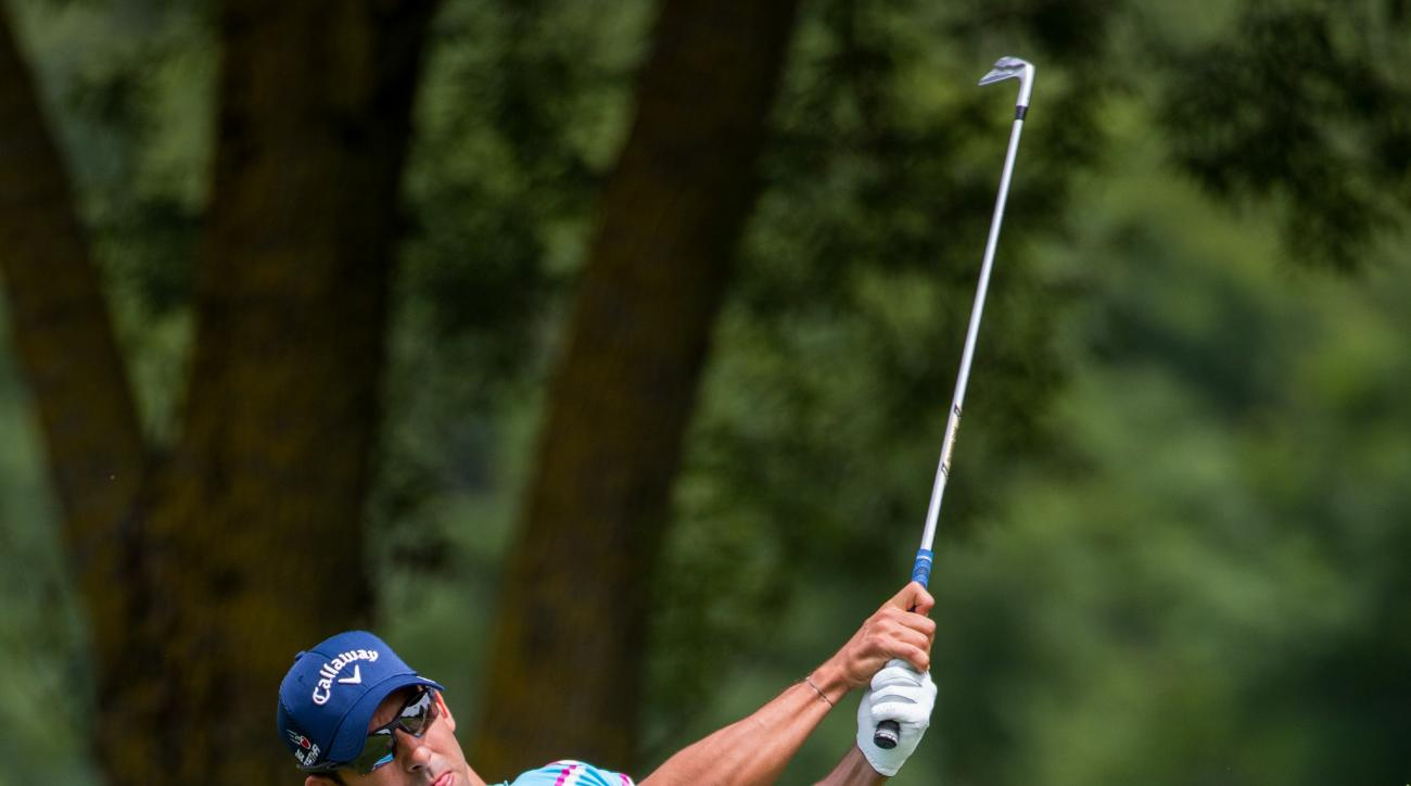 Pablo Larrazabal of Spain hits at the European Tour golf tournament in Eichenried Germany, Thursday June 25,  2015. England's Andrew Johnston shot a 6-under 66 Thursday to take the clubhouse lead in the opening round of the BMW International Open.Compatri