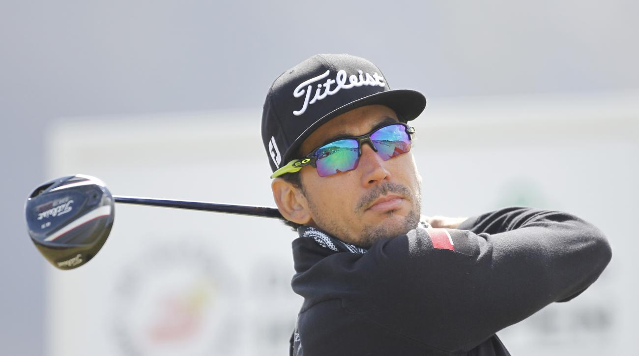 Spain's Rafa Cabrera-Bello tees off on the 11th hole during the final round of the Irish Open Golf Championship at Royal County Down, Newcastle, Northern Ireland, Sunday, May 31, 2015.  (AP Photo/Peter Morrison)