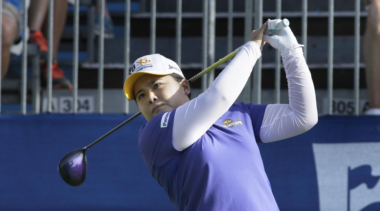 Inbee Park, of South Korea, watches her opening tee shot in the first round of the NW Arkansas Championship LPGA golf tournament at Pinnacle Country Club in Rogers, Ark., Friday, June 26, 2015. (AP Photo/Danny Johnston)