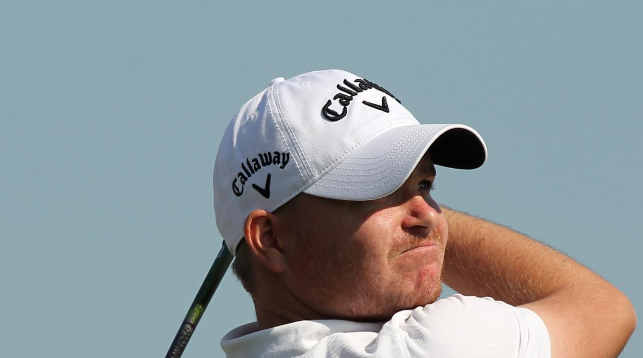 James Morrison of England hits his tee shot on the ninth hole during the first round of the Commercial Bank Qatar Masters at the Doha Golf Club in Doha, Qatar, Wednesday, Jan. 22, 2014. (AP Photo/Osama Faisal)