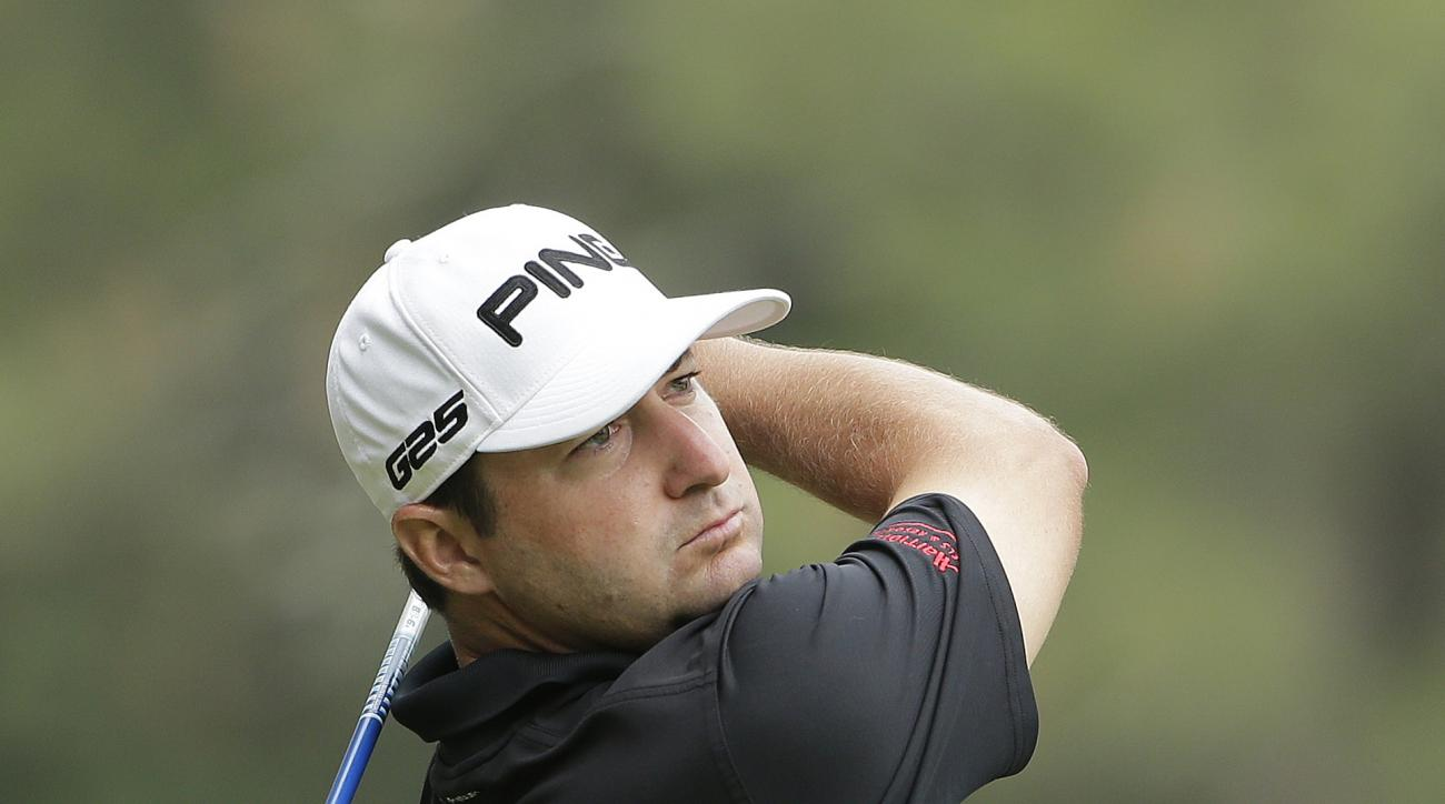 Rob Oppenheim watches his tee shot on the second hole during the first round of the U.S. Open golf tournament in Pinehurst, N.C., Thursday, June 12, 2014. (AP Photo/Chuck Burton)