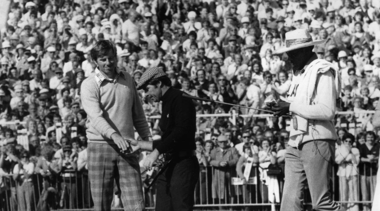 FILE - In this July 13, 1974, file photo, Gary Player, center, and Peter Oosterhuis shake hands after the final of the British Open Championship at Royal Lytham and St. Anne's in Lancashire, England. Oosterhuis, 67, said on Monday, June 29, 2015, that he
