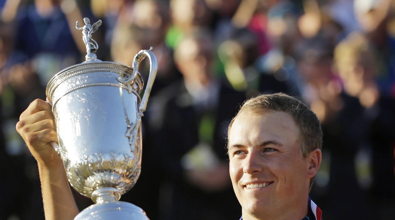FILE - In this Sunday, June 21, 2015, file photo, Jordan Spieth holds up the trophy after winning the U.S. Open golf tournament at Chambers Bay in University Place, Wash. Spieth loves golf history, which is appropriate for someone quickly becoming part of
