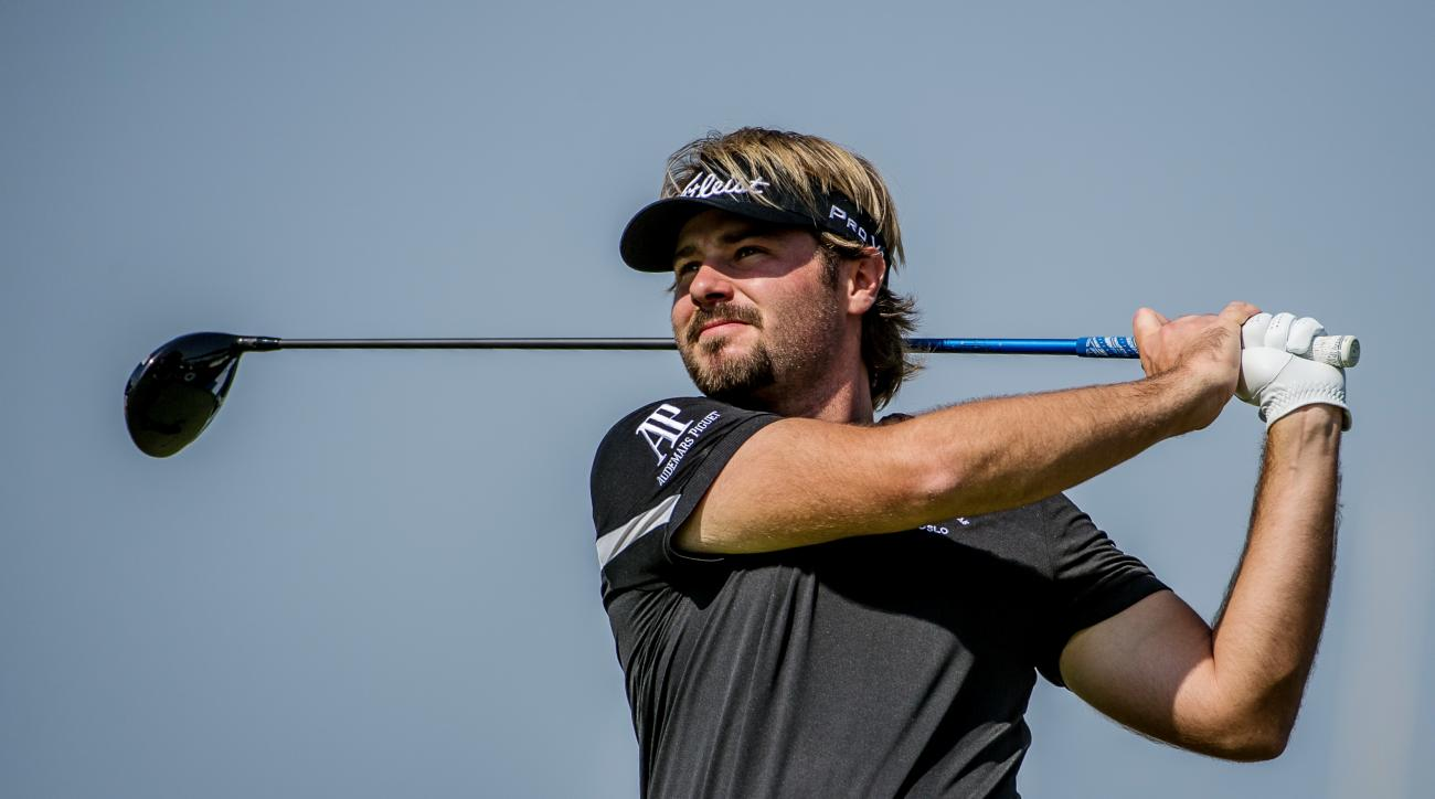 Victor Dubuisson of France tees off at the 2nd hole, during the first day of The DP World Tour Championship, held at Jumeirah Golf Estates in Dubai, United Arab Emirates, on Thursday,  Nov. 20, 2014. (AP Photo/Stephen Hindley)