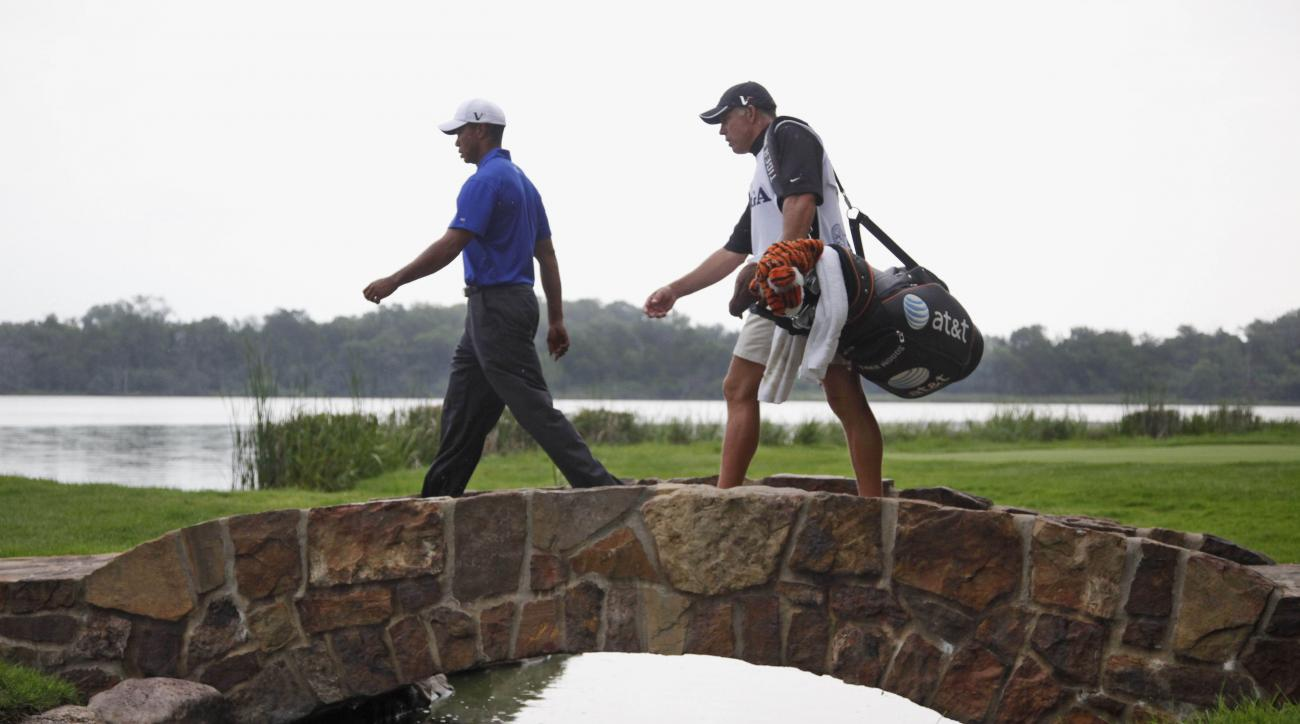 FILE - In this Aug. 15, 2009, file photo, Tiger Woods, left, crosses a bridge on the 16th fairway with caddie Steve Williams during the third round of the PGA Championship golf tournament at Hazeltine National Golf Club in Chaska, Minn. Organizers of golf