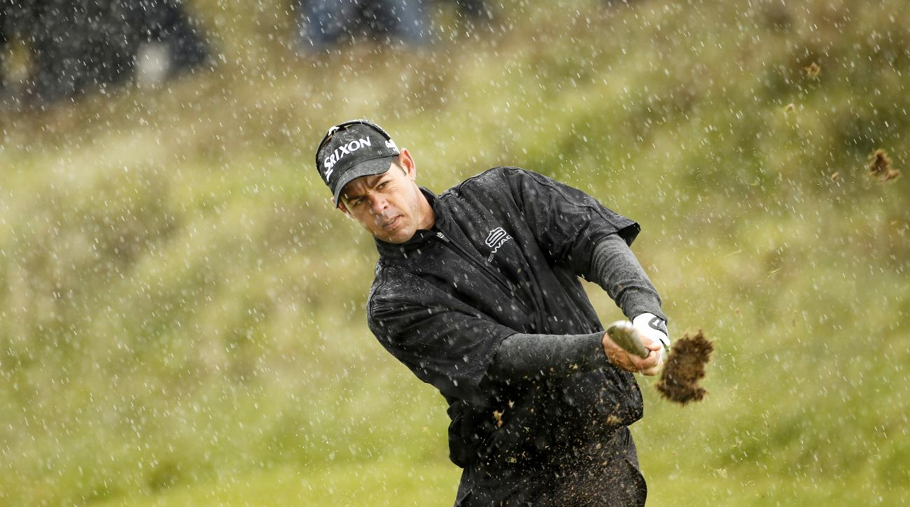 South Africa's Jaco Van Zyl plays his second shot on hole 18 during round one of the Irish Open Golf Championship at Royal County Down, Newcastle, Northern Ireland, Thursday, May 28, 2015.  (AP Photo/Peter Morrison)