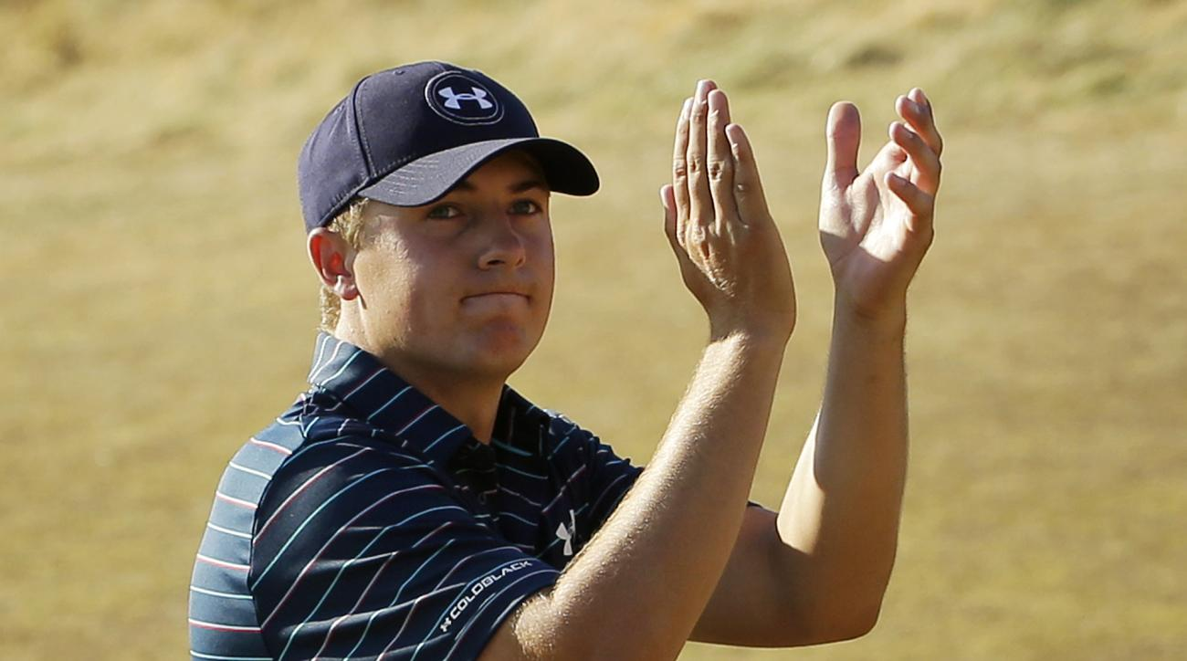 FILE - In this June 21, 2015, file photo, Jordan Spieth claps after finishing the final round of the U.S. Open golf tournament at Chambers Bay in University Place, Wash. Spieth isn't taking the traditional route to the British Open. Rather than prep for S