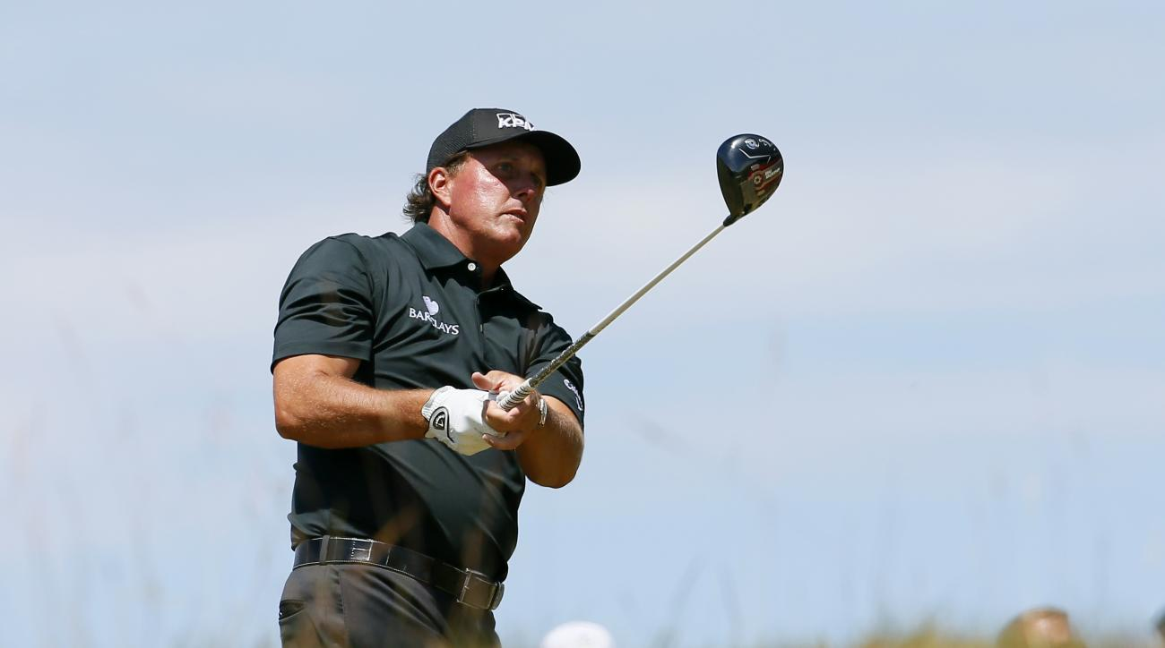 Phil Mickelson watches his tee shot on the 18th hole during the final round of the U.S. Open golf tournament at Chambers Bay on Sunday, June 21, 2015 in University Place, Wash. (AP Photo/Matt York)