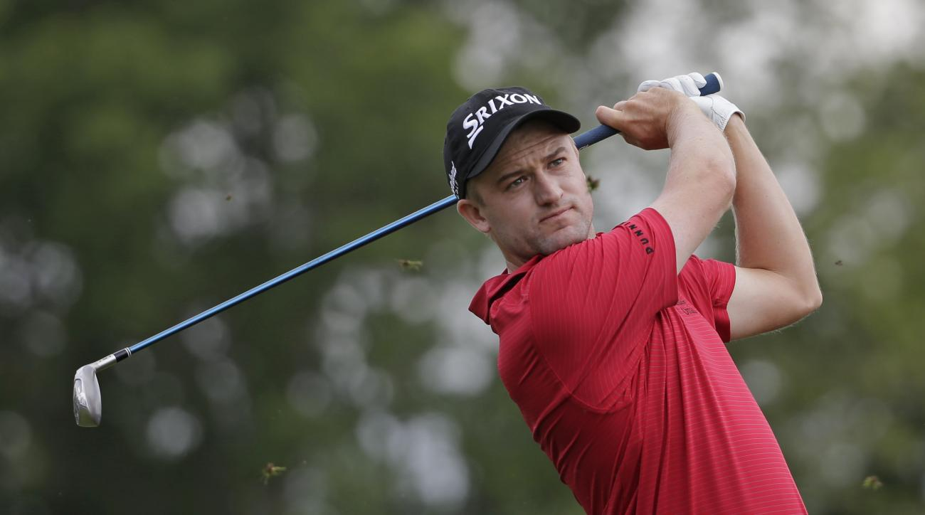 FILE - In this Friday, May 15, 2015 file photo, Russell Knox watches his tee shot on the 17th hole during the second round of the Wells Fargo Championship golf tournament at Quail Hollow Club in Charlotte, N.C.. Knox has been given a place in the British
