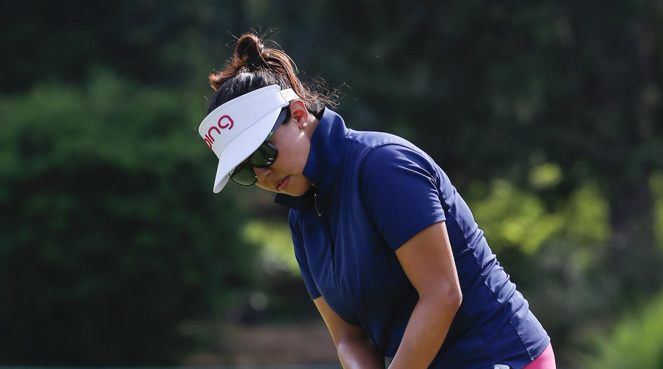 Jane Park sinks a putt for a birdie on the 10th green during the first round of the U.S. Women's Open golf tournament at Lancaster Country Club, Thursday, July 9, 2015 in Lancaster, Pa. (AP Photo/Gene J. Puskar)