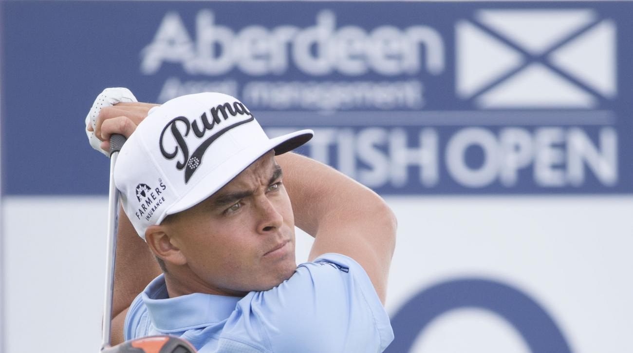 US golfer Rickie Fowler tees off at the 10th hole during day two of the Scottish Open at Gullane Golf Club, Gullane Scotland  Friday July 10, 2015.  (Kenny Smith/PA via AP) UNITED KINGDOM OUT  NO SALES NO ARCHIVE