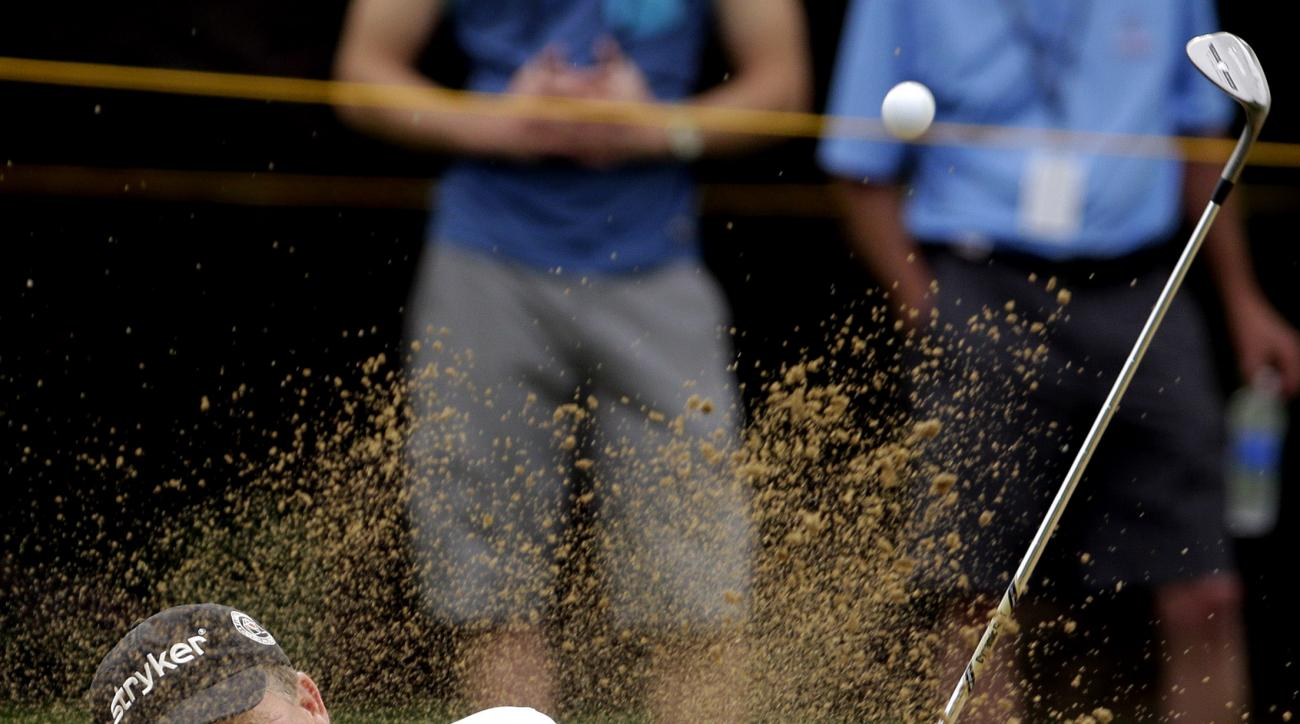 Fred Funk hits out of a sand trap on the 10th during the second round of the Encompass Championship golf tournament Saturday, July 11, 2015, in Glenview, Ill. (AP Photo/Nam Y. Huh)