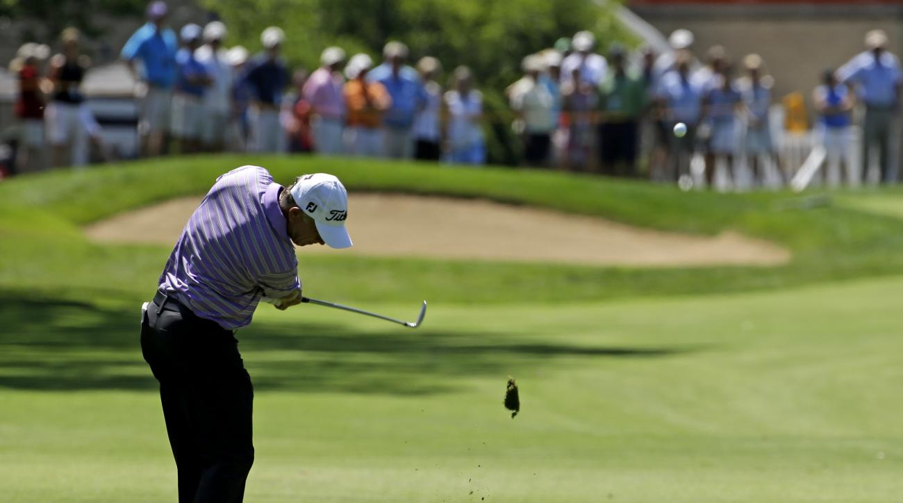 Mike Goodes hits his second shot on the ninth fairway during the final round of the Encompass Championship golf tournament Sunday, July 12, 2015, in Glenview, Ill. (AP Photo/Nam Y. Huh)