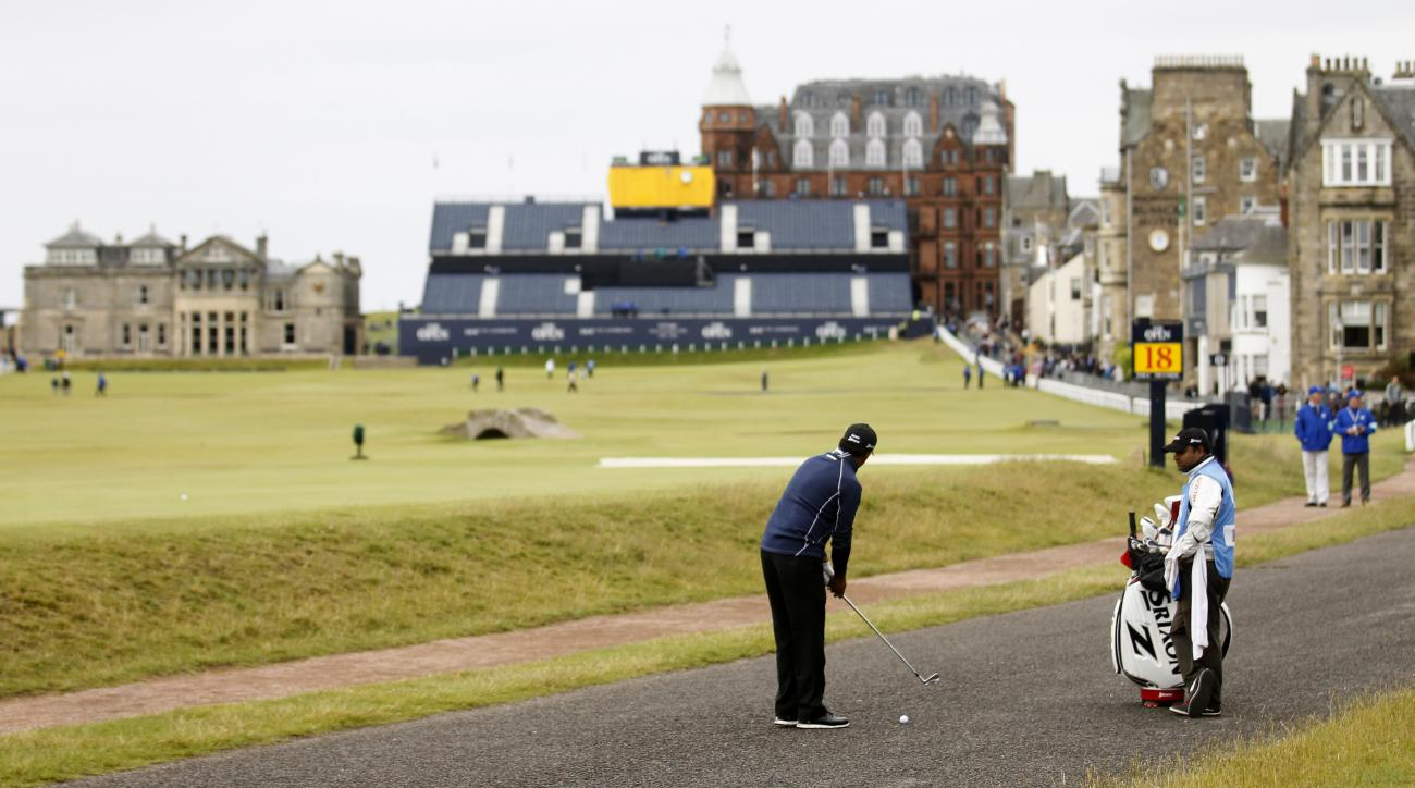 India's Anirban Lahiri plays from the path on the 17th hole at the Old Course, St Andrews, Scotland, Monday, July 13, 2015.  Lahiri played a practice round ahead of the 2015 Open Golf Championship that is due to take place at St. Andrews July16-19.  (AP P