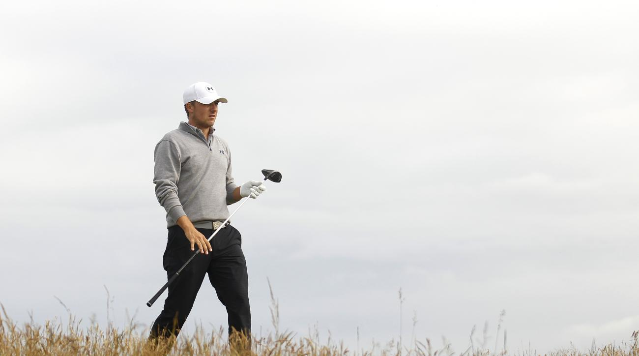 Jordan Spieth from the U.S. walks from the 6th tee box during a practice round at St. Andrews Golf Club prior to the start of the British Open Golf Championship, in St. Andrews, Scotland, Monday, July 13, 2015. (AP Photo/Peter Morrison)