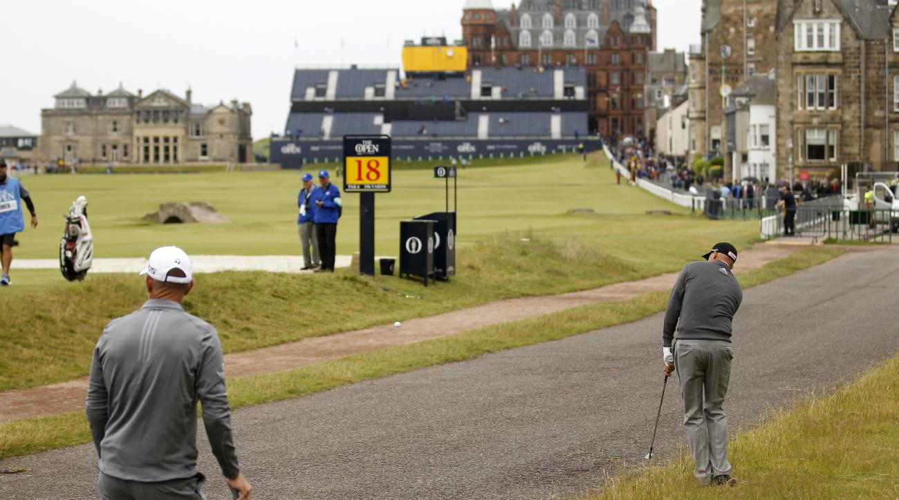 Bill Haas from the U.S. plays from the path on the 17th hole during a practice round at St. Andrews Golf Club prior to the start of the British Open Golf Championship, in St. Andrews, Scotland, Monday, July 13, 2015. (AP Photo/Peter Morrison)