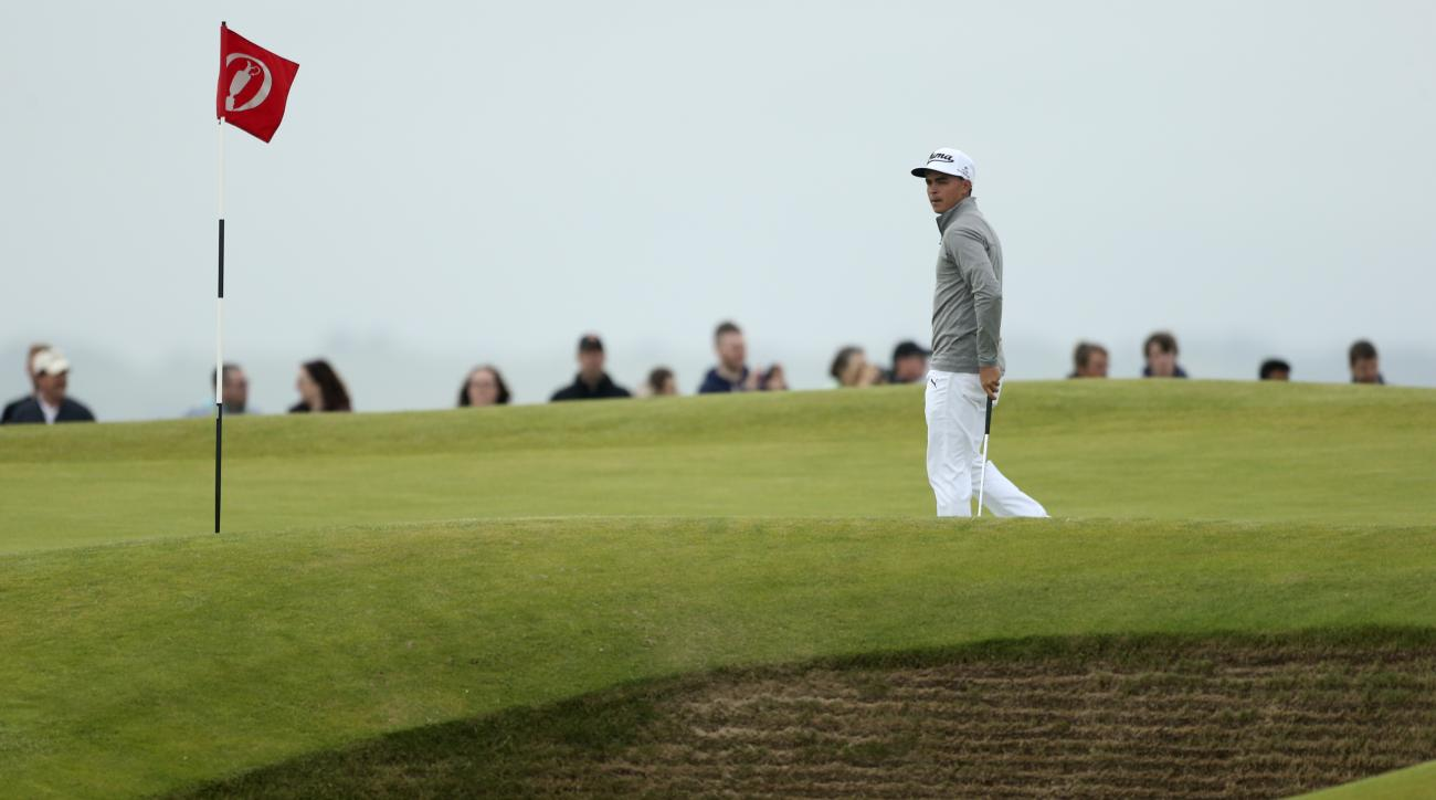 United States' Rickie Fowler walks next to a bunker on the 11th hole during a practice round at the British Open Golf Championship at the Old Course, St. Andrews, Scotland, Tuesday, July 14, 2015. (AP Photo/Peter Morrison)