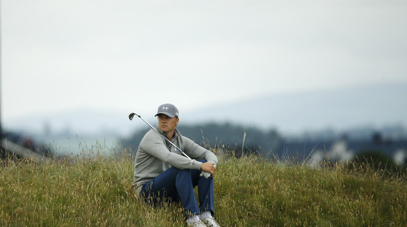 United States' Jordan Spieth sits in the rough on hole four during a practice round at the British Open Golf Championship at the Old Course, St. Andrews, Scotland, Tuesday, July 14, 2015. (AP Photo/Jon Super)