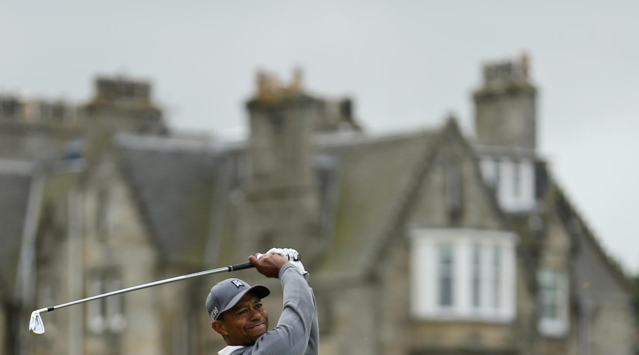 United States' Tiger Woods follows his drive from the second tee during the first round of the British Open Golf Championship at the Old Course, St. Andrews, Scotland, Thursday, July 16, 2015. (AP Photo/Peter Morrison)