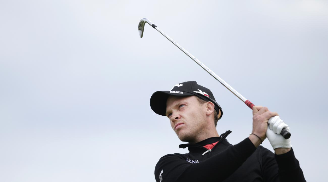 England's Danny Willett drives a ball from the 11th tee during the second round of the British Open Golf Championship at the Old Course, St. Andrews, Scotland, Friday, July 17, 2015. (AP Photo/Alastair Grant)