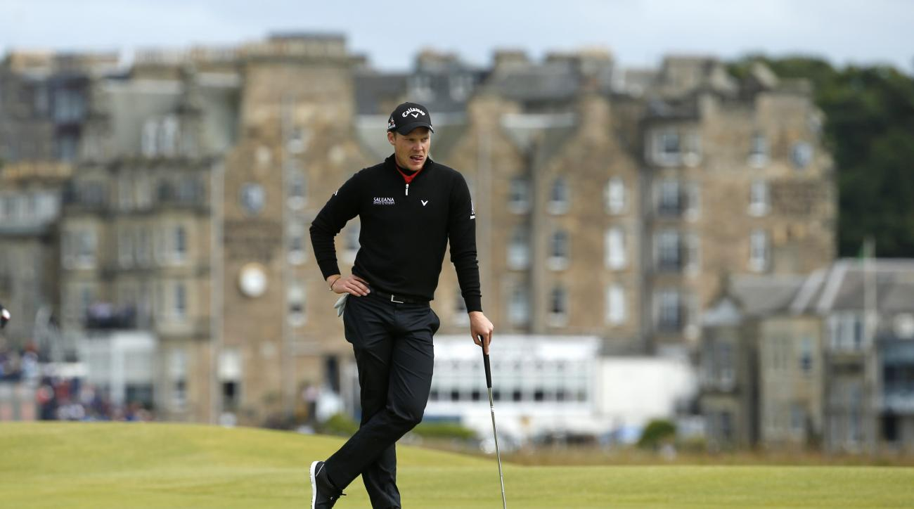 England's Danny Willett waits to play on the 16th green during the second round of the British Open Golf Championship at the Old Course, St. Andrews, Scotland, Friday, July 17, 2015. (AP Photo/Jon Super)