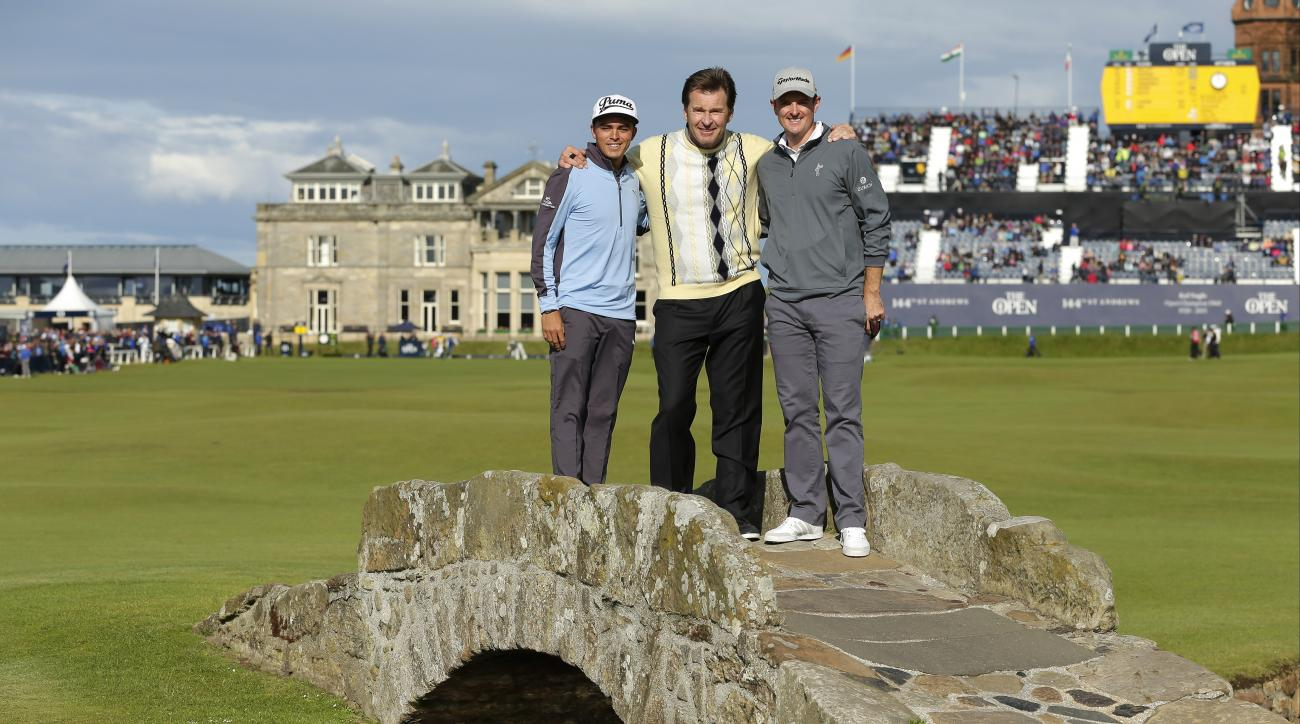 From left, United States' Rickie Fowler, England's Nick Faldo, and England's Justin Rose pose for photographers on Swilcan Bridge during the second round of the British Open Golf Championship at the Old Course, St. Andrews, Scotland, Friday, July 17, 2015