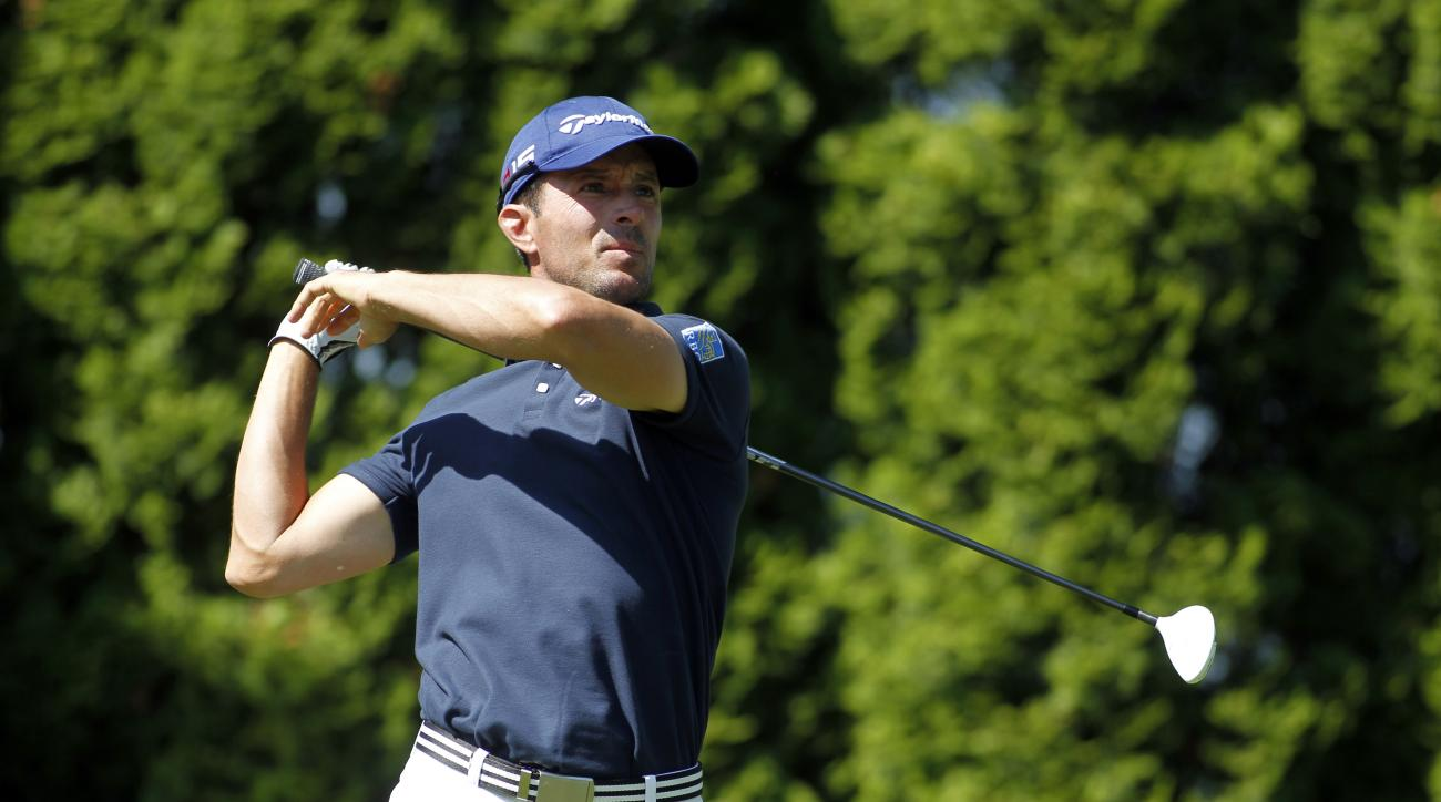 Mike Weir, of Canada, tees off on the ninth hole during the first round of the Travelers Championship golf tournament, Thursday, June 25, 2015, in Cromwell, Conn. (AP Photo/Stew Milne)
