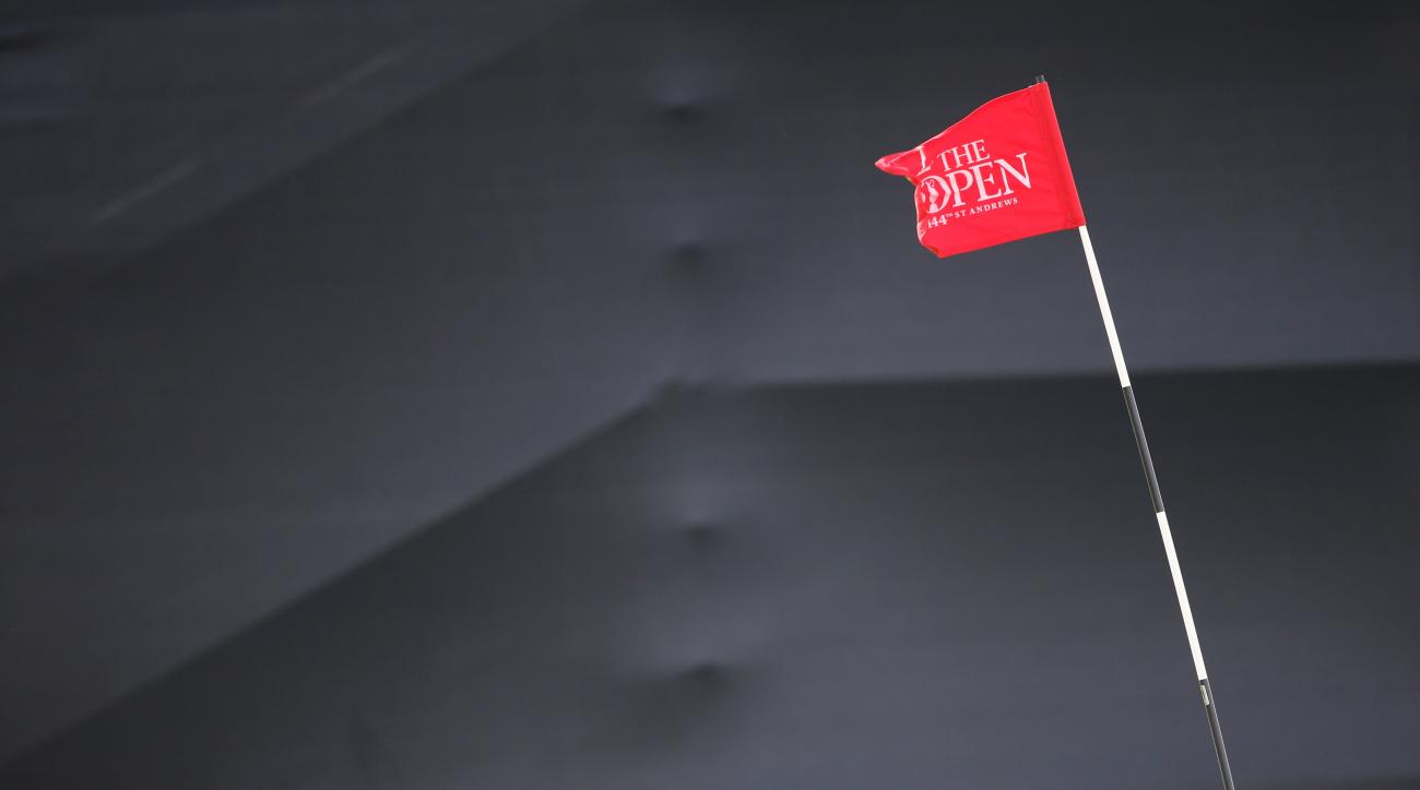 A pin marker sways in the wind on the 12th green after high winds forced a suspension in play of the second round of the British Open Golf Championship at the Old Course, St. Andrews, Scotland, Saturday, July 18, 2015. (AP Photo/Peter Morrison)