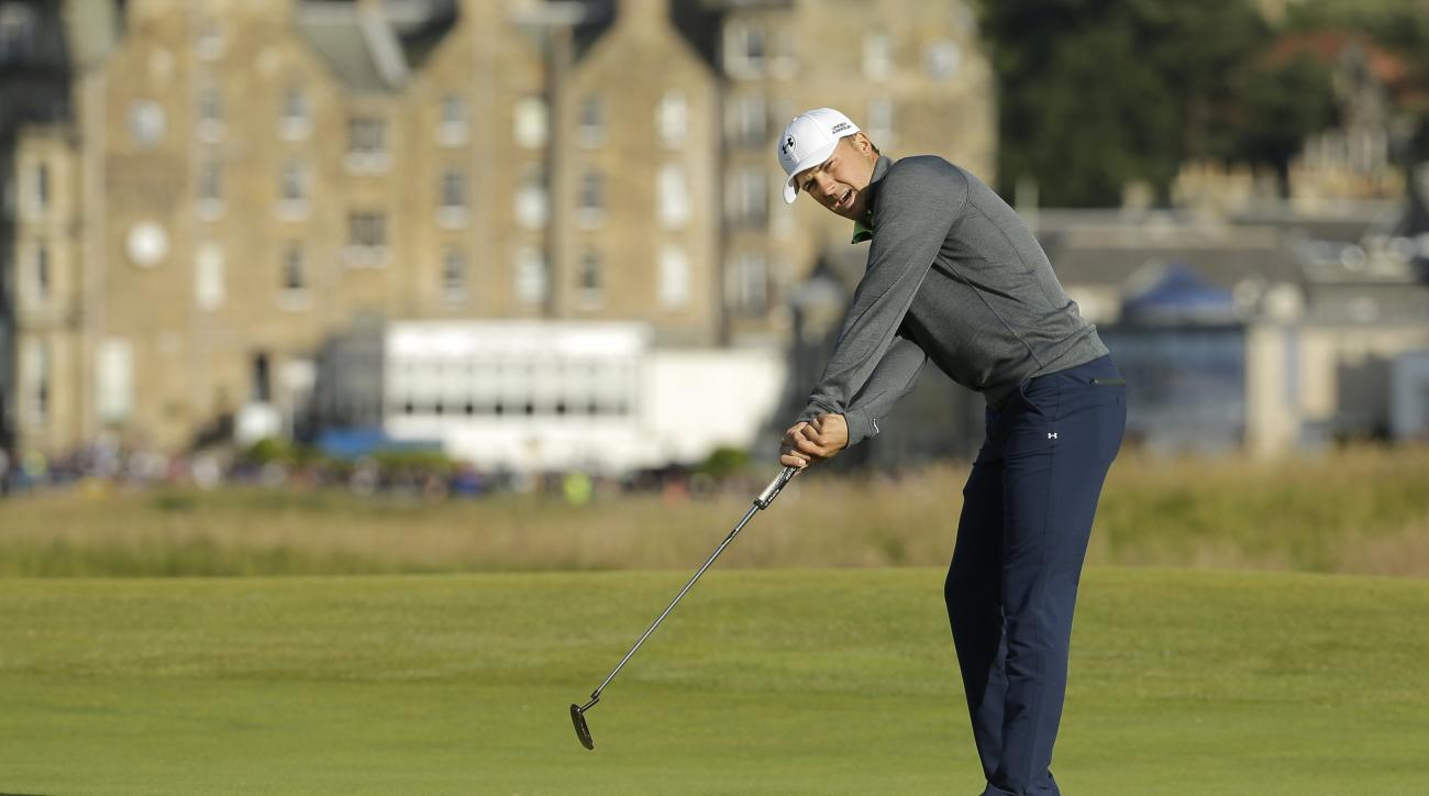 United States' Jordan Spieth putts on the 16th green during the second round of the British Open Golf Championship at the Old Course, St. Andrews, Scotland, Saturday, July 18, 2015. (AP Photo/David J. Phillip)