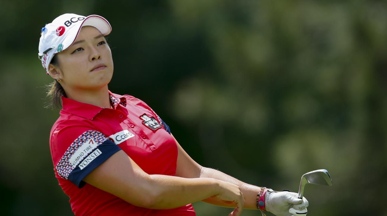 Ha Na Jang of South Korea watches her tee shot on the second hole during the third round of the Marathon Classic golf tournament at Highland Meadows Golf Club in Sylvania, Ohio, Saturday, July 18, 2015. (AP Photo/Rick Osentoski)