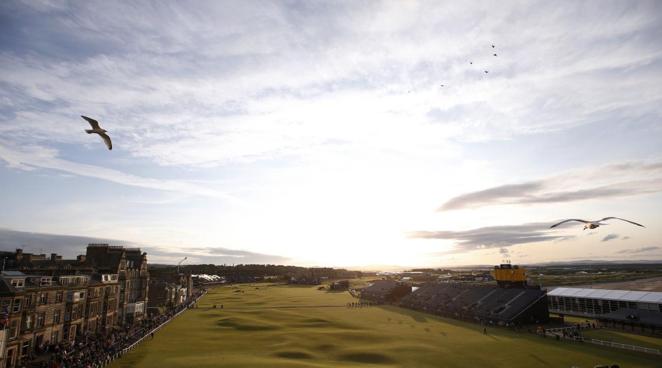 A view down the 18th fairway towards the end of delayed second round of the British Open Golf Championship at the Old Course, St. Andrews, Scotland, Saturday, July 18, 2015. (AP Photo/Alastair Grant)