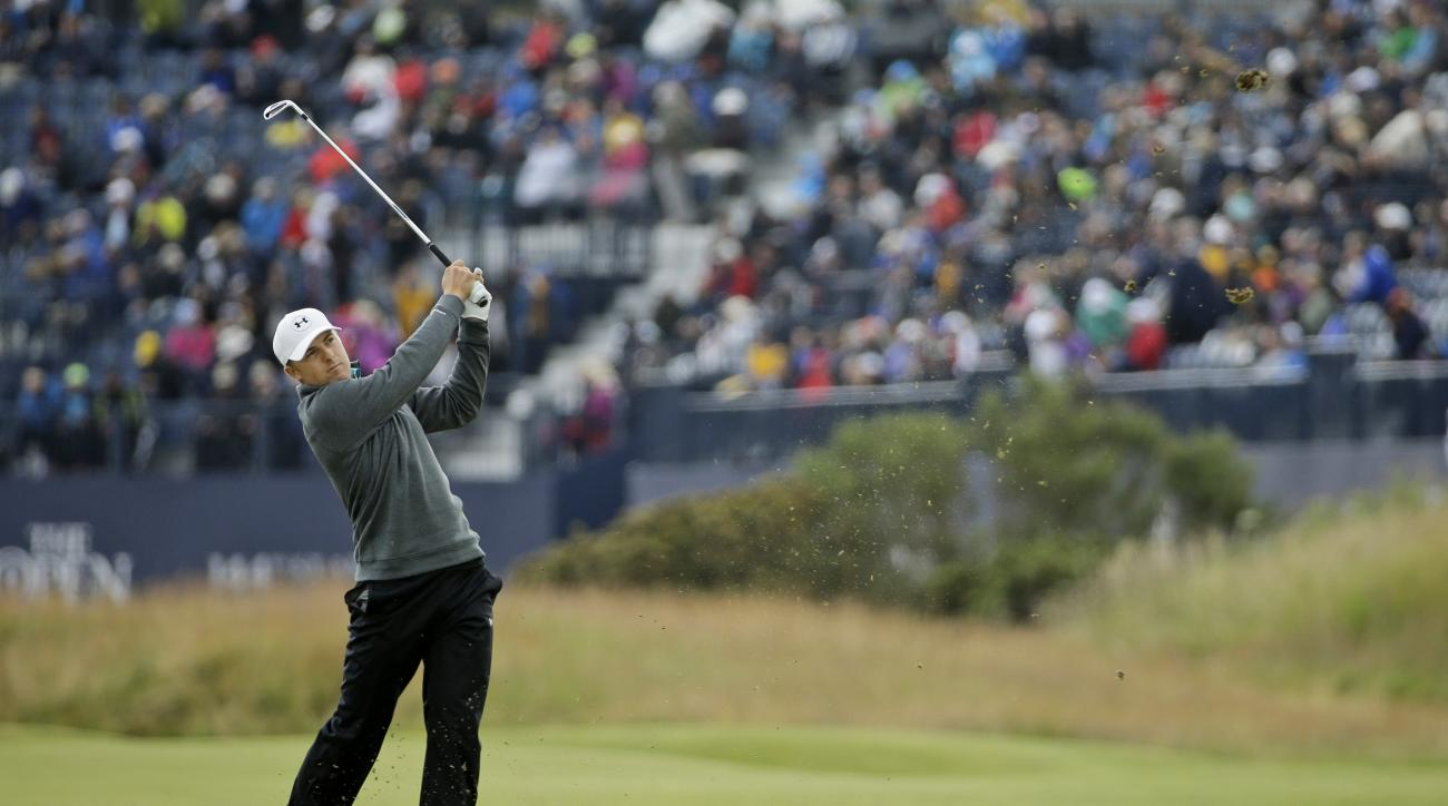 United States' Jordan Spieth plays from the second fairway during the third round at the British Open Golf Championship at the Old Course, St. Andrews, Scotland, Sunday, July 19, 2015. (AP Photo/David J. Phillip)