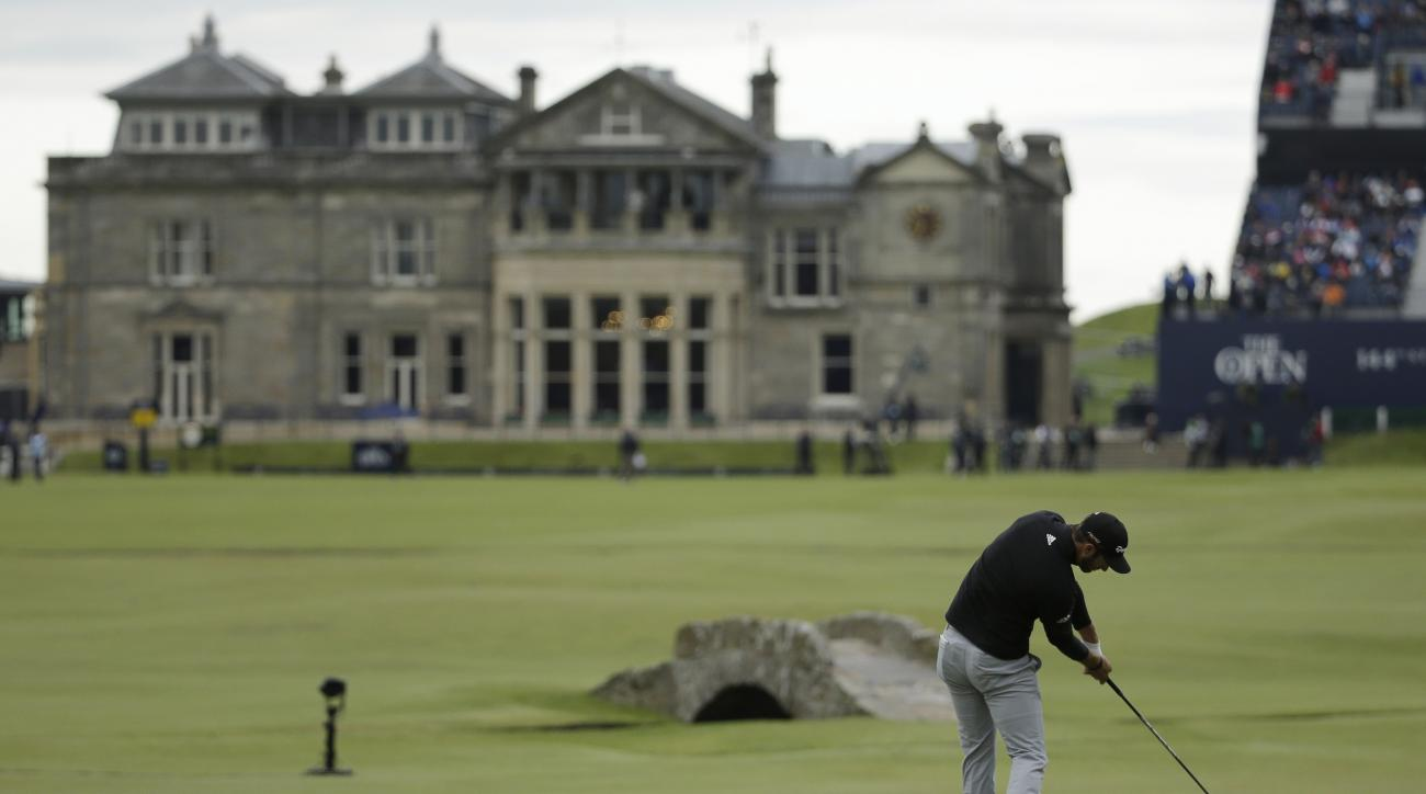United States' Dustin Johnson plays from the 18th tee during the third round at the British Open Golf Championship at the Old Course, St. Andrews, Scotland, Sunday, July 19, 2015. (AP Photo/David J. Phillip)
