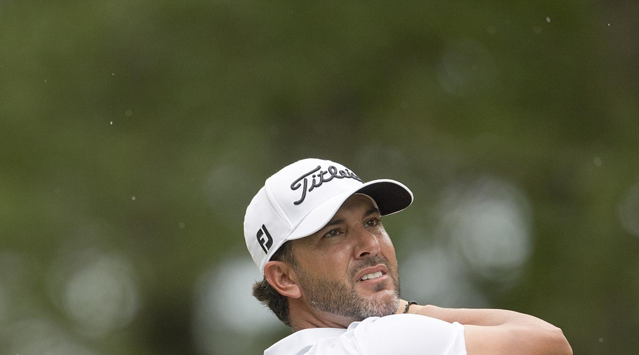 Scott Piercy tees off the fourth hole during the final round of the Barbasol Championship golf tournament Sunday, July 19, 2015, in Opelika, Ala. (AP Photo/Butch Dill)