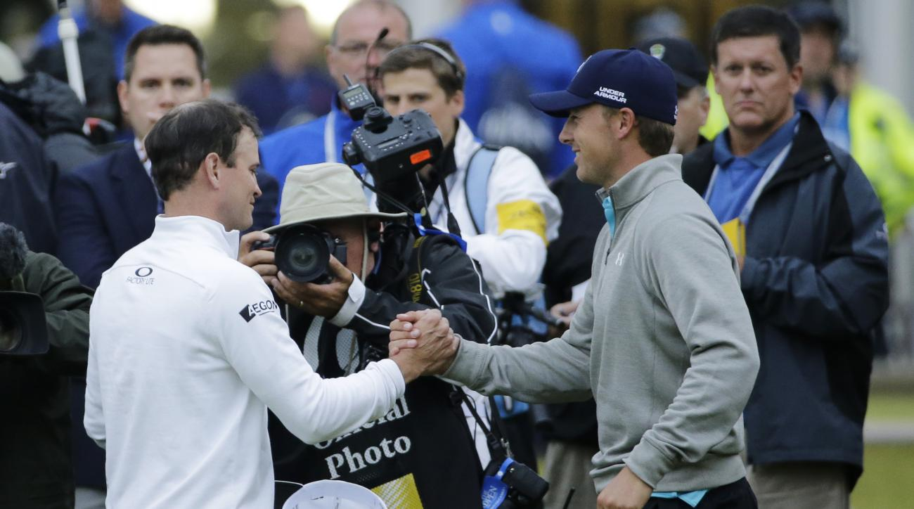 United States' Zach Johnson, left, is congratulated by United States' Jordan Spieth after winning a playoff after the final round of the British Open Golf Championship at the Old Course, St. Andrews, Scotland, Monday, July 20, 2015. (AP Photo/David J. Phi