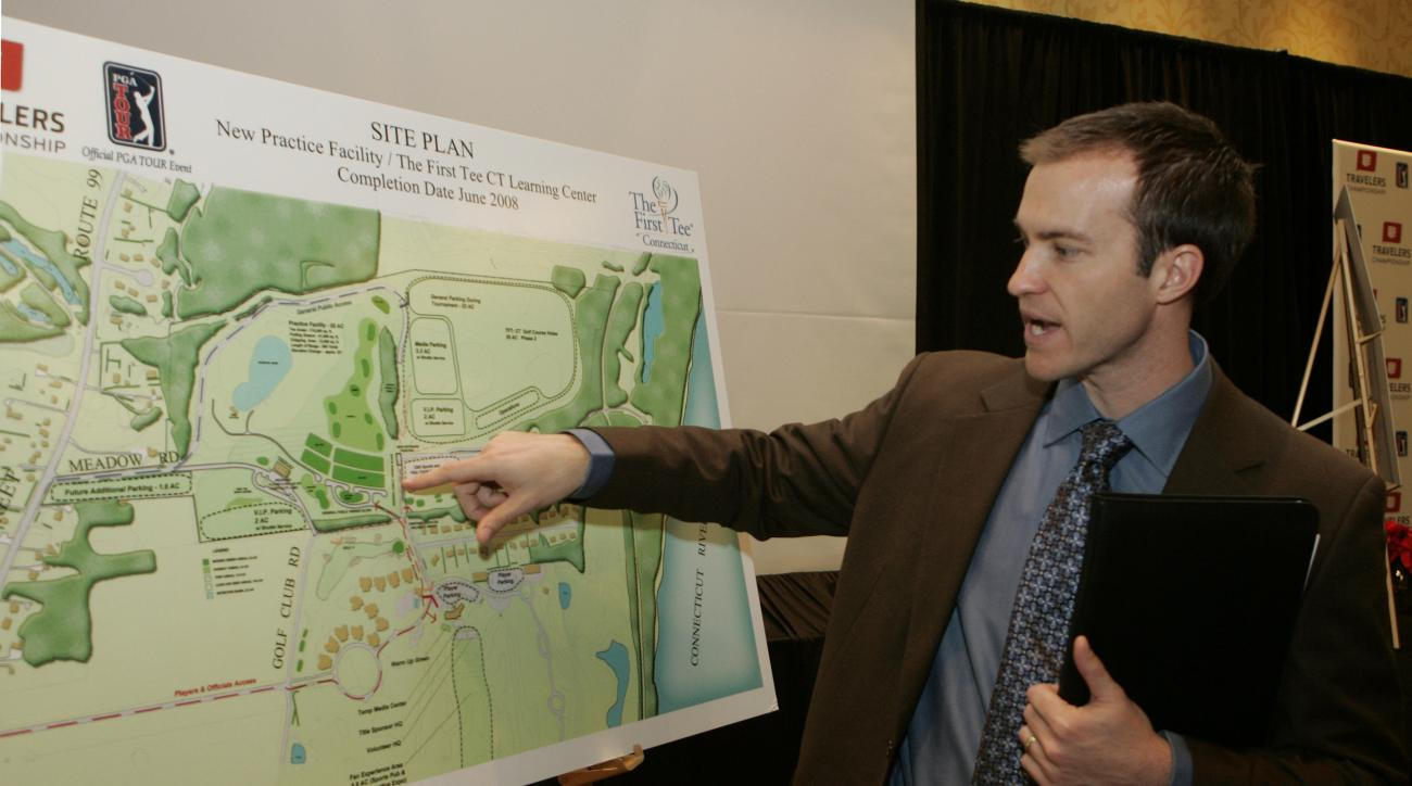 Nathan Grube, Travelers Championship golf tournament director, points out changes to be made to the TPC at River Highlands facility over the next two years, at a news conference, Thursday, Dec. 7, 2006, in Hartford, Conn. A total purse of amounting to ove