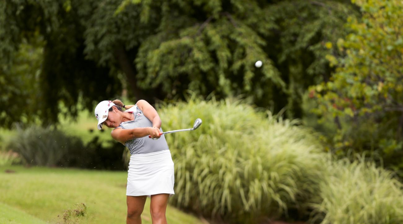 In a photo provided by the USGA, Naomi Ko plays her second shot on the second hole during the second round of match play in the U.S. Girls' Junior golf tournament at Tulsa Country Club in Tulsa, Okla. on Thursday, July 23, 2015. (Steven Gibbons/USGA via A