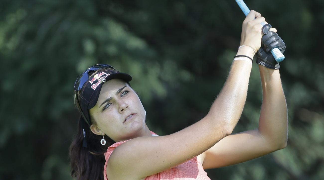 Lexi Thompson drives on the ninth hole during the second round of the Meijer LPGA Classic golf tournament at Blythefield Country Club, Friday, July 24, 2015 in Belmont, Mich. (AP Photo/Carlos Osorio)